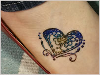 henna foot heart design